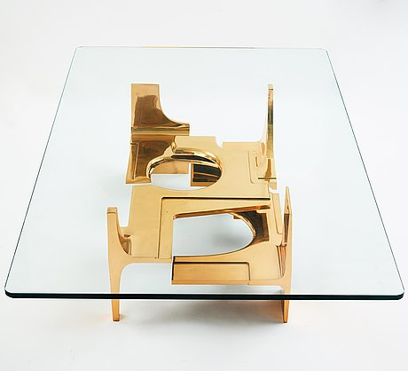 Gerard mannoni, a polished bronze and glass sofa table, france 1974.