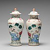 A pair of famille rose vases with covers, qing dynasty, qianlong (1736-95).