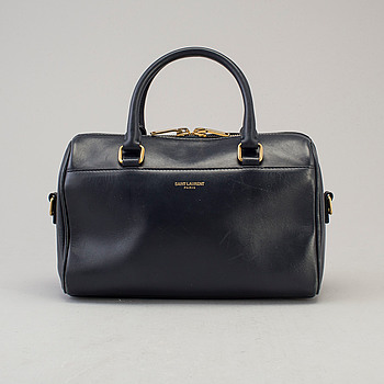 A Classic Baby Duffle bag by Yves Saint Laurent.