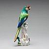 A meissen figure of a parrot, circa 1900.