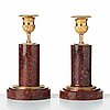 Two matched of 19th century empire-style porphyry  candlesticks.