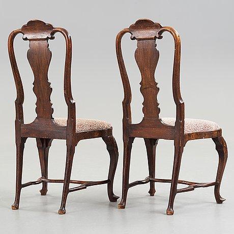 A pair of dutch rococo 18th century chairs.