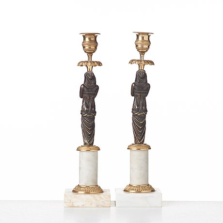 A pair of late gustavian circa 1800 white marble and bronze candlesticks.