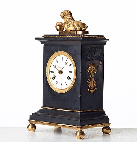 An empire mantel clock by p h beurling, master in stockholm 1783.