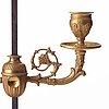 An empire-style 19th century lampe à bouillotte.