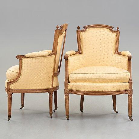 A pair of louis xvi late 18th century bergeres by claude lerat (master in paris 1785).