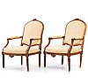 A pair of louis xvi late 18th century armchairs.