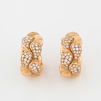 "CHOPARD, a pair of ""Casmir"" earrings set with brilliant cut diamonds."