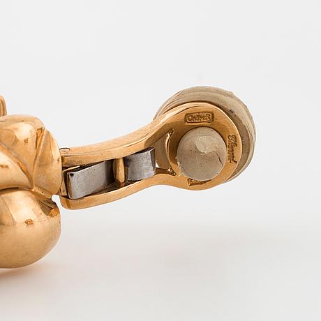 "Chopard, a pair of ""casmir"" earrings set with brilliant cut diamonds."