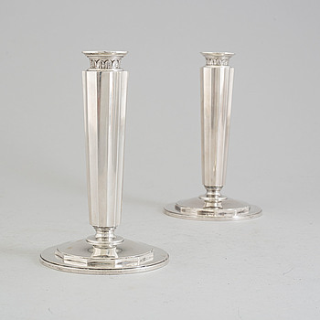 A pair of sterling silver candle sticks by Atelier Borgila. Stockholm 1956.