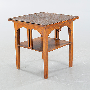 CARL CHRISTIAN CHRISTENSEN, a jugend smoking table, signed and dated 1910.