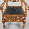 Carl christian christensen, a baroque style armchair, signed and dated 1909.