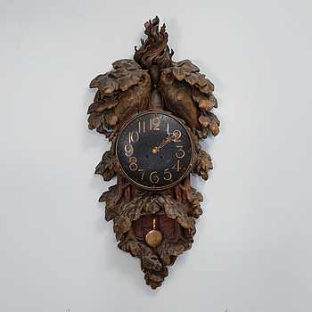 A wall clock by CARL CHRISTIAN CHRISTENSEN, signed and dated 1905.