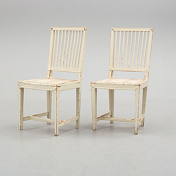 a pair of late 18th century Gustavian chairs.