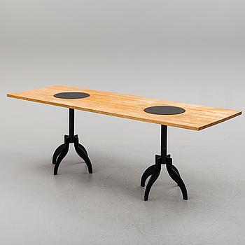 A  dining table by Jonas Bohlin för Källemo.