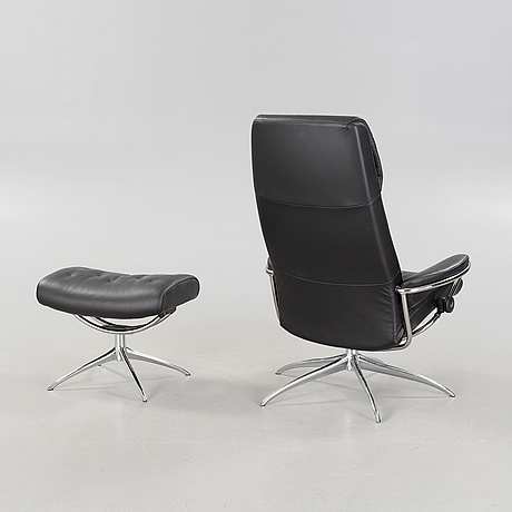 A Lounge Chair And Foot Stool From Ekornes In Norway Model