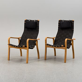 A pair of Yngve Ekström easy chairs, Swedese, second half of the 20th Century.