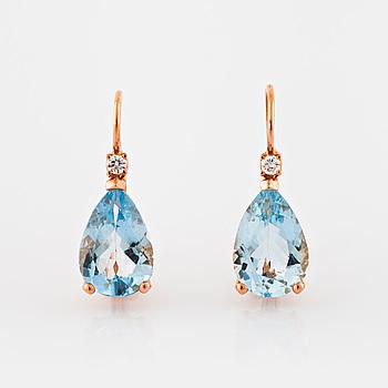 EARRINGS, A pair of pear cut aquamarine and brilliant cut diamond earrings.
