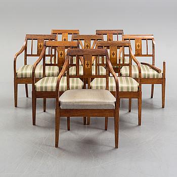 Eight mid 19th century oak armchairs.