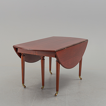 A second half of the 20th century mahogany dining table with 5 additional leaves.