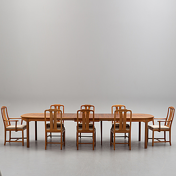 A walnut dining table with 3 additional leaves, six chairs and two armchairs by Carl Malmsten.