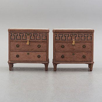 A pair of Gustavian style painted chest of drawers.