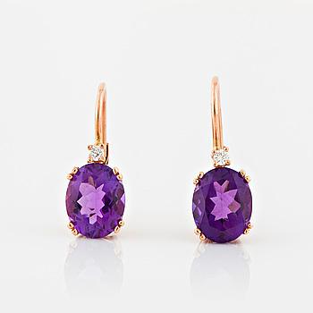 EARRINGS, A pair of oval cut amethyst and brilliant cut diamond earrings.