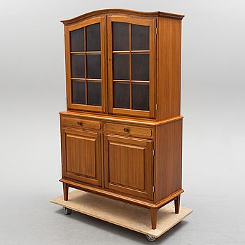 A late 20th century walnut veneered display cabinet.