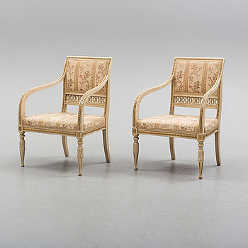 A pair of first half of the 19th century Empire arm chairs.