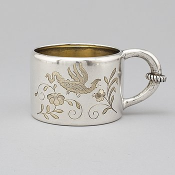 A Russian 19th century parcel-gilt silver mugg, mark of Mikhail Gratchev, St. Petersburg 1895. Imperial Warrant.