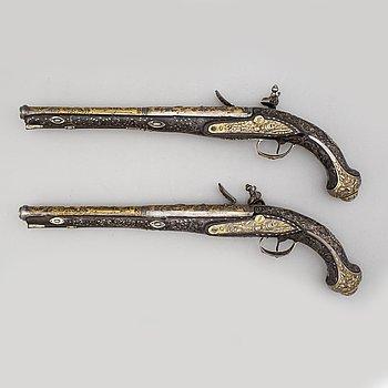 A pair of composite flintlock pistols marked Jalabert Lamotte.