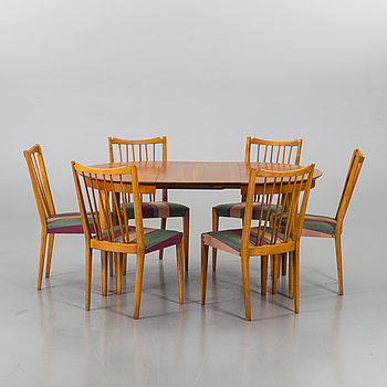 A TABLE AND 6 CHAIRS, mid 20th century.