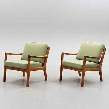 A pair of Ole Wanscher 'Senator' teak easy chairs, for France & Son, Denmark, second half of the 20th century.