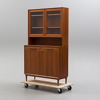 A 1950/60s century teak veneered display cabinet.