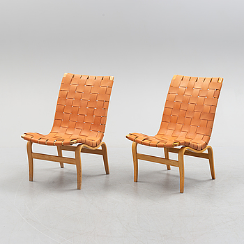 A pair of Bruno Mathsson 'Eva' lounge chairs, by Karl Mathsson, for VÄrnamo, 1965 and 1970.