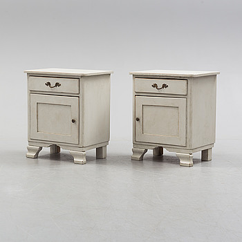 A pair of painted pine bedside tables.