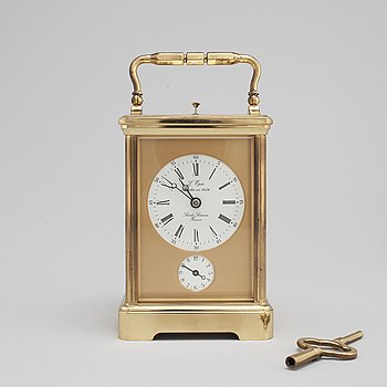 A brass carriage clock from L'Epée, France.