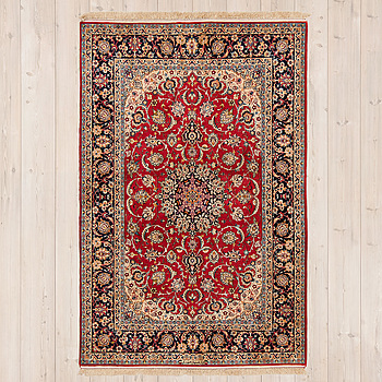RUG, from Esfahan, part silk,  signed Safteri, around 233 x 135 cm.