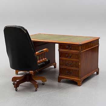 A second half of the 20th century writing desk and chair.