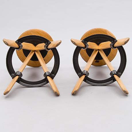 Tom dixon, a pair of 21st century 'slab bar stools'.