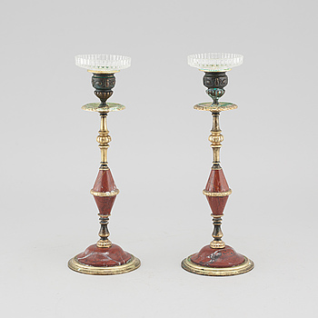 A pair of brass and red marble candle sticks from the late 19th century.