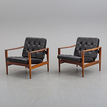 A pair of 1960's rosewood easy chairs, by Illum Wikkelsö for Niels Eilersen, Denmark.