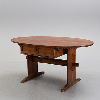 A 19th century pine table.