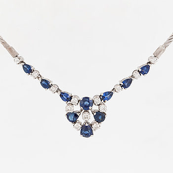 A diamond sapphire necklace.