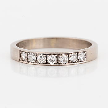 An half-eternity diamond ring.