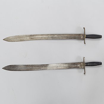 A pair of Swedish cutlasses 1810 pattern.