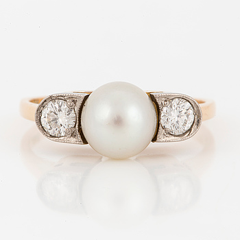 A brilliant-cut diamond and pearl ring.