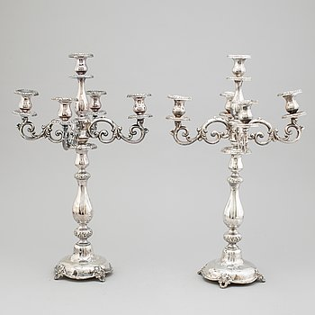 A pair of silver candelabra by Lars Larsson, Stockholm, 1870.