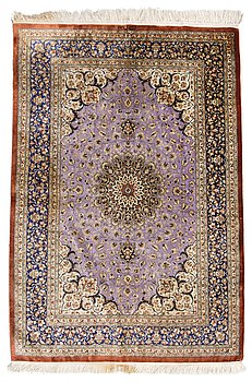 65. A SILK CARPET, Ghom, signed, 150x102 cm.