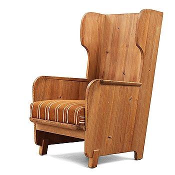 "306. Axel Einar Hjorth, a ""Lovö"" stained pine armchair, Nordiska Kompaniet, Sweden, 1930's."